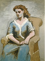 1923 Woman seated in an armchair