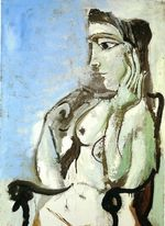 Female nude sitting in the armchair