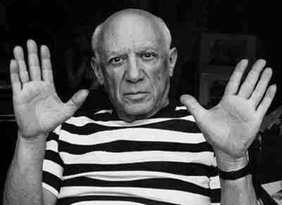 Pablo Picasso showing his hands